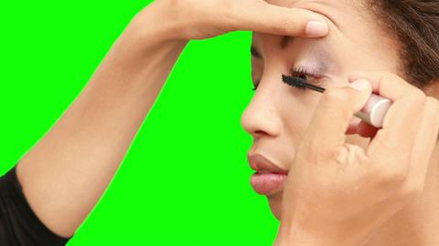 Make up artist putting mascara on models face Live Action