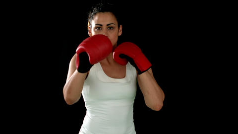 Brunette punching in boxing gloves Footage
