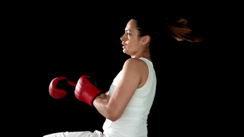 Brunette kicking in boxing gloves Footage