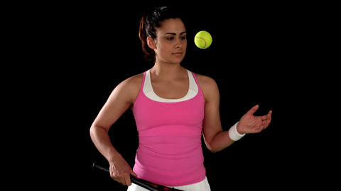Brunette tennis player bouncing ball Footage