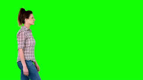 Casual Brunette Walking On Green Screen stock footage