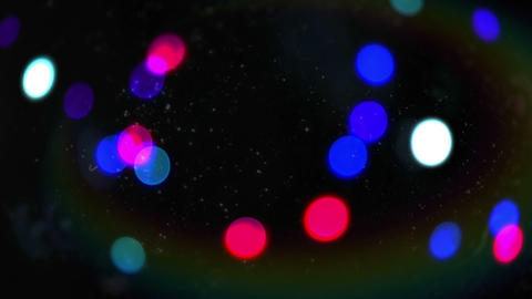 Glowing circles of light moving on black Animation