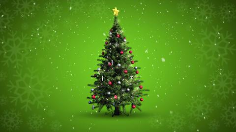 Snow falling christmas tree against snowflake patt Footage
