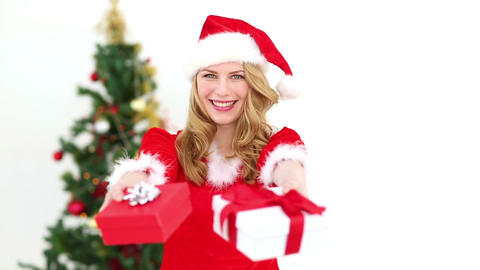 Festive blonde offering christmas gifts Footage