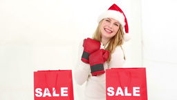 Festive blonde with sale shopping bags Footage