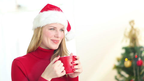 Festive blonde enjoying hot chocolate Footage