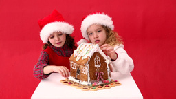 Cute Festive Sisters Making A Ginger Bread House stock footage