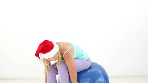 Fit Festive Blonde Working Out In Santa Hat stock footage