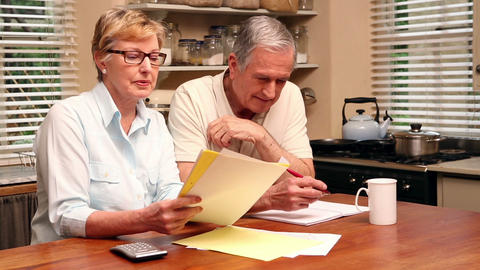 Older Couple Paying Their Bills stock footage