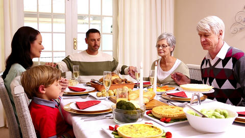 Three Generation Family Saying Grace Before Christ stock footage