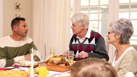 Three Generation Family Having Christmas Dinner To stock footage