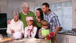 Three Generation Family Baking Together stock footage