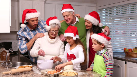 Three Generation Family Baking Together At Christm stock footage
