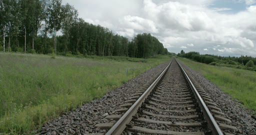 Railway Track Of A Train With Green Grass Around F stock footage