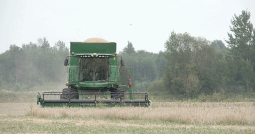 A wheat harvester running on the field Footage