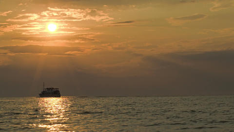 Sailing Ship In Quiet Sea At Sunset Footage
