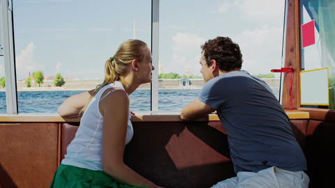 Young Couple Traveling By Touristic Boat Footage