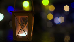 Outdoor lantern with lit candle Footage