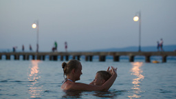 Evening bathing in sea of mother and son Footage