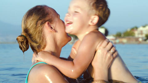 Boy Kissing And Embracing Mother In Sea Footage