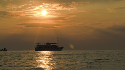 Tourist Ship Leaving Pier At Sunset stock footage