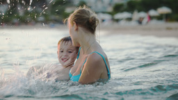 Little Boy Having Fun With Mother In Sea Footage