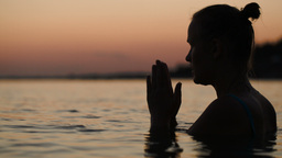 Woman In Water Praying Or Meditating stock footage