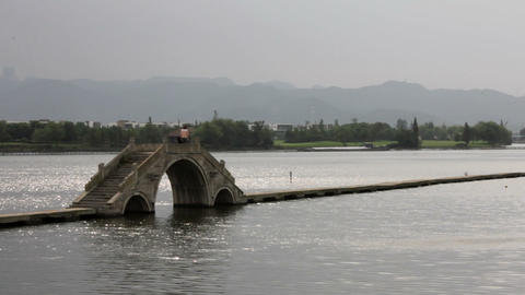Traditional Stone Bridge over a River in China Footage