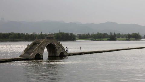 Traditional Stone Bridge over a River in China Stock Video Footage