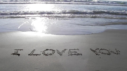 i love you written on sand sunset waves beach roma Footage