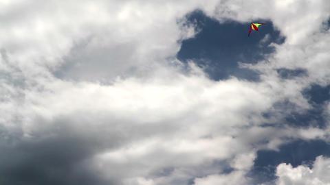 Kite flying in dense cloud Stock Video Footage