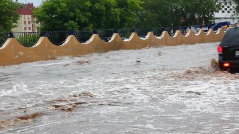 floodingin town streetsafter torrential rain Stock Video Footage