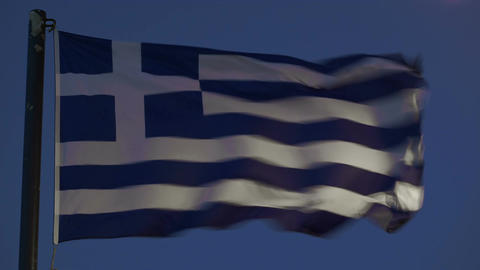Greek Flag Fluttering Against Evening Sky stock footage