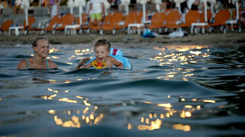 Mother And Son Swimming In The Evening stock footage