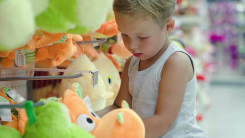 Boy choosing toy in the shop Footage