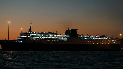 Illuminated cruise ship in late evening Footage