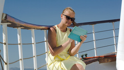 Woman Using Pad During Sea Traveling stock footage