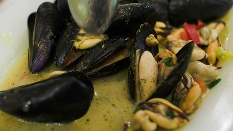 Eating Dish With Mussels stock footage