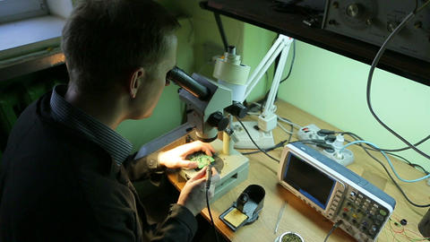 Scientist in the laboratory looking into a microsc Footage