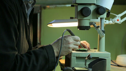 Scientist solder , close up Footage