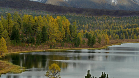 4K UHD Mountain Lake And Snowy Peaks In Autumn stock footage