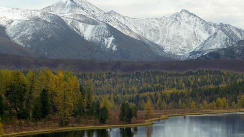 Stock Footage Snowy Mountains Above Mountain Lake  Footage