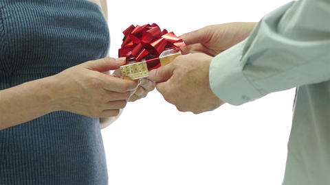Man Giving Girl Gift Red Bow Behind View Footage