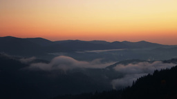 Dawn Mist in the Forested Mountains. Time Lapse Footage