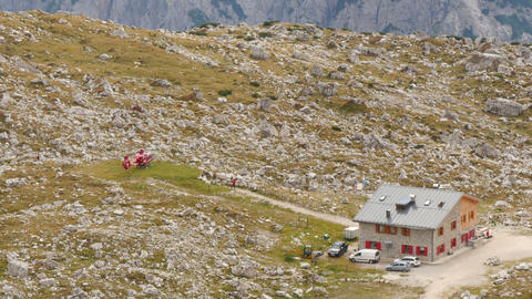 helicopter prepare start in dolomite alps 11541 Footage