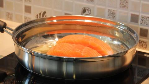 Salmon Frying In Pan stock footage