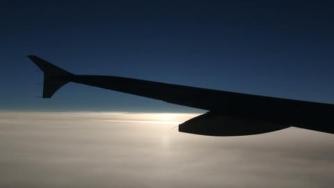 Sun Blinking Behind An Airplane Wing stock footage