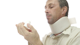 Male In Neck Support Brace Taking Pills stock footage