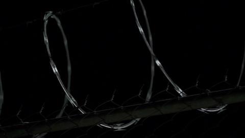 Razor Wire Night Dolly Footage