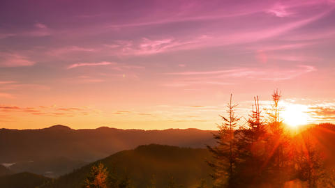 Sunrise Over The Forested Mountains. Time Lapse 4K stock footage